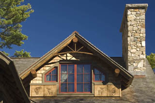 Sculptured burned wood exterior detail on Squam Lake camp