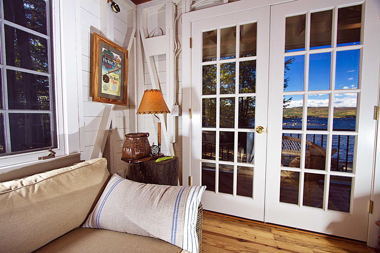 Reused and repositioned windows and doors capture lakeside views and breezes.