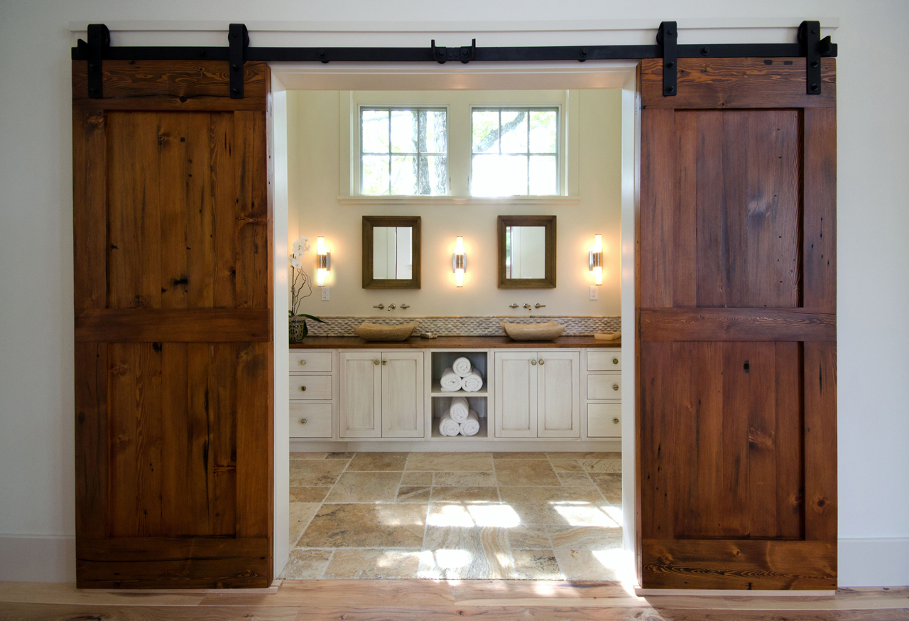 Custom barn doors create a dramatic entrance to the master bath.